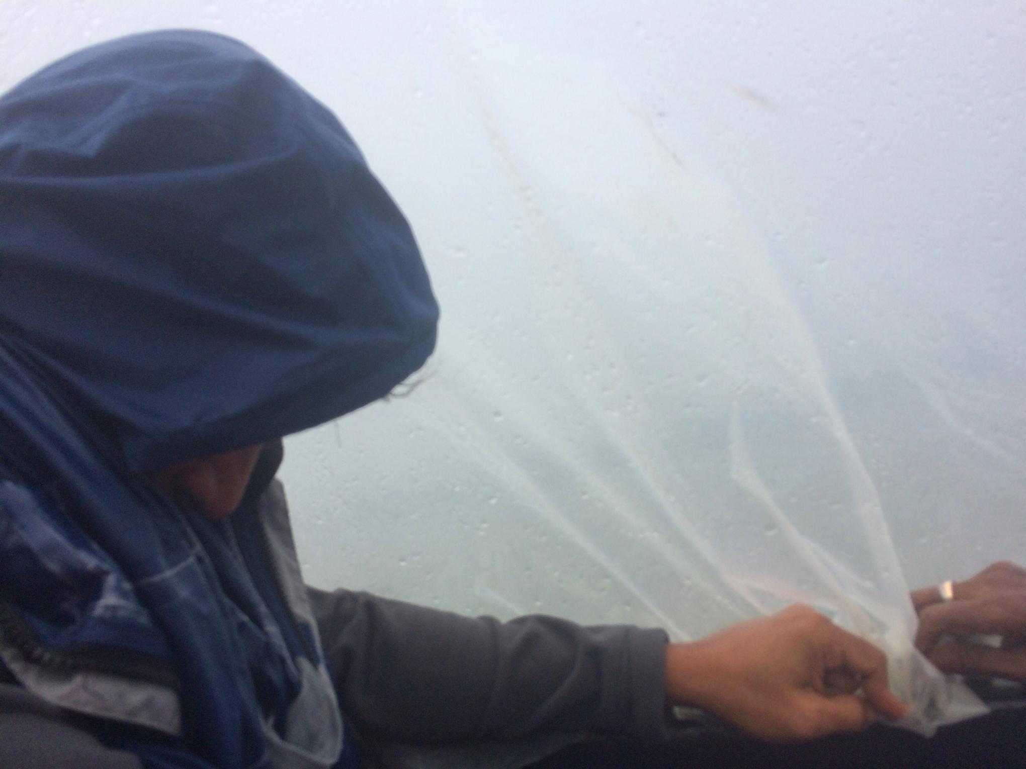 hidding like a refuge under a tarp